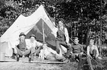 220px unidentified group of men camping